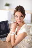 Portrait of a businesswoman sitting at  desk with  laptop — Foto de Stock