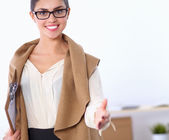 Young business woman ready to handshake standing in office — Stock Photo