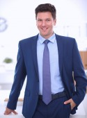 Business man or manager standing against his desk at the office — Stock Photo