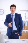 Business and office concept - handsome businessman with open hand ready for handshake — Stock Photo