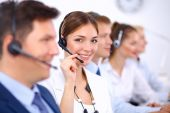 Attractive Smiling positive young businesspeople and colleagues in a call center office — Stock Photo