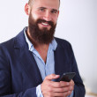 Close up of a man using mobile smart phone, isolated on white background — Stock Photo #63133297