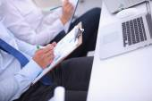 Business people sitting and writting at business meeting, in office — Stock Photo