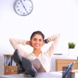 Business woman  relaxing with  hands behind her head and sitting on an office chair — Stock fotografie #69467673