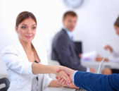 Business people shaking hands, finishing up a meeting, in office — Stock Photo