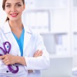 Portrait of happy successful young female doctor holding a stethoscope — Stock Photo #71303995