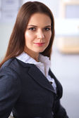 Attractive businesswoman sitting  in the office — Stock Photo