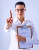 Woman touching an imaginary screen with her finger , holding a folder- isolated — Stock Photo