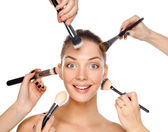 Closeup portrait picture of beautiful woman with brushes — Stock Photo