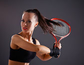 Female tennis player with racket ready to hit a tennis  — Stock Photo