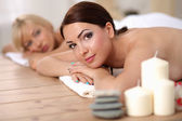 Two young beautiful women relaxing and enjoying at the spa center — Stock Photo