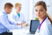 Medical team sitting at the table in modern hospital — Stock Photo