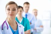 Woman doctor standing with stethoscope at hospital — Stock Photo