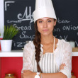 Chef woman portrait with  uniform in the kitchen — Stockfoto #80859374