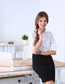 Attractive businesswoman standing in office — Stock Photo