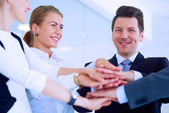 Business people with their hands together in a circle — Stock Photo
