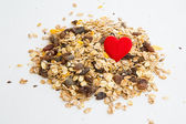 Pile of muesli and a heart — Stock Photo