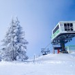 Chairlift cable car and ski slopes in the mountains — Stockfoto #65278357