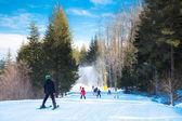 Skiers on the slope in Bansko, Bulgaria — Stock Photo