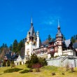 Spring view of Peles Castle with snowy Bucegi Mountains in the background. — Stock Photo #72827695