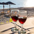 Two glasses with red wine and Sunset on beach  at the background — Stock Photo #75132799