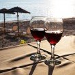 Two glasses with red wine and Sunset on beach  at the background — Stock Photo #75132869
