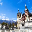Spring view of Peles Castle with snowy Bucegi Mountains in the background. — Stock Photo #75547021