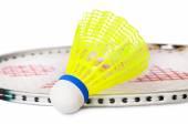 One shuttlecock lying near the badminton racket — Stock Photo