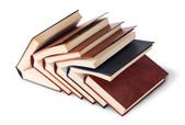 Six old books imbedded in one another top and front view — Stock Photo