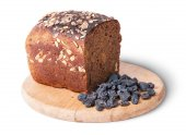 Unleavened bread with seeds on wooden board with raisins — Stock Photo