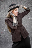 Beautiful hipster style woman in hat — Stock Photo