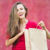 Shopping woman over red — Stock Photo