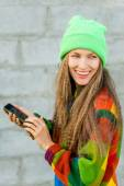 Beautiful young woman with cell phone — Stock Photo