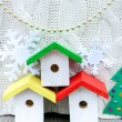 Colorful birdhouses on rustic background — Stock Photo #58973409