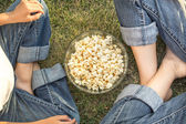 Family with popcorn — Stock Photo