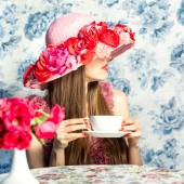 Beautiful stranger with cup of tea — Stock Photo
