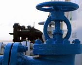 The blue valve on the pipeline — Stock Photo