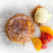 Apple pie in puff pastry served with ice cream and candied fruit — Stock Photo #70616593