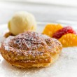 Apple pie in puff pastry served with ice cream and candied fruit — Stock Photo #70616733