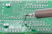The Solder electronics PCB with the soldering iron — Stock Photo