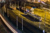 Night city from high point with trains — Stock Photo