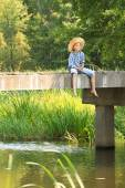 Boy during angling with rod on bridge — Foto de Stock