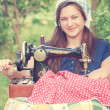 Young seamstress with vintage hand sewing machine — Stock Photo #54470897