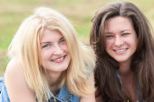 Blonde and brunette girls portrait — Stock Photo