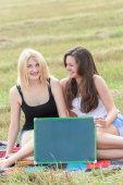 Student girls holding board for writing — Stock Photo