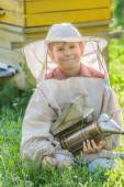 Young beekeeper with painted wooden beehives — Foto Stock