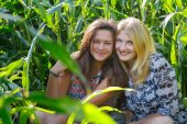 Portrait of young women at corn field background — Stock Photo