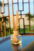 Incense sticks in the tank with oil — Stock Photo