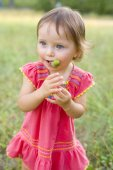Funny little girl with acorns — Stock Photo
