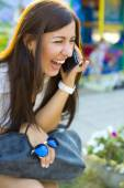 Beautiful young brunette woman, talking on the phone — Stock Photo
